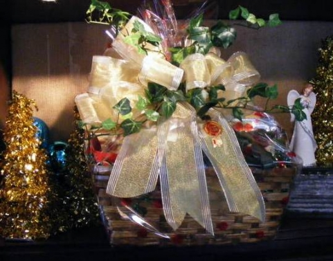 Custom holiday gift basket with gold ribbon