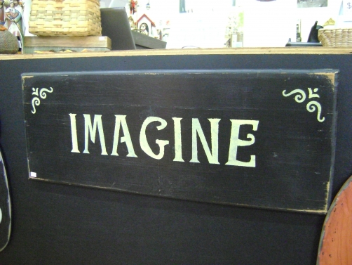 Handpainted sign by Bessie Mae's Cabin