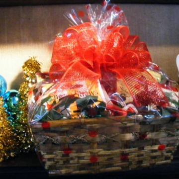 Custom holiday gift basket with red ribbon