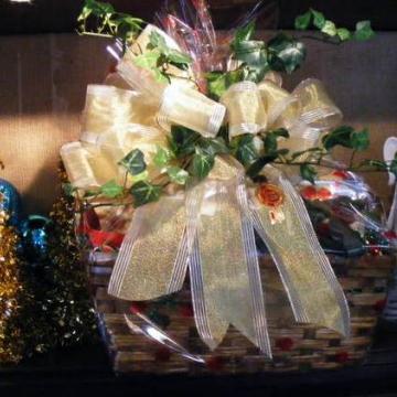 Custom holiday gift basket with gold ribbon